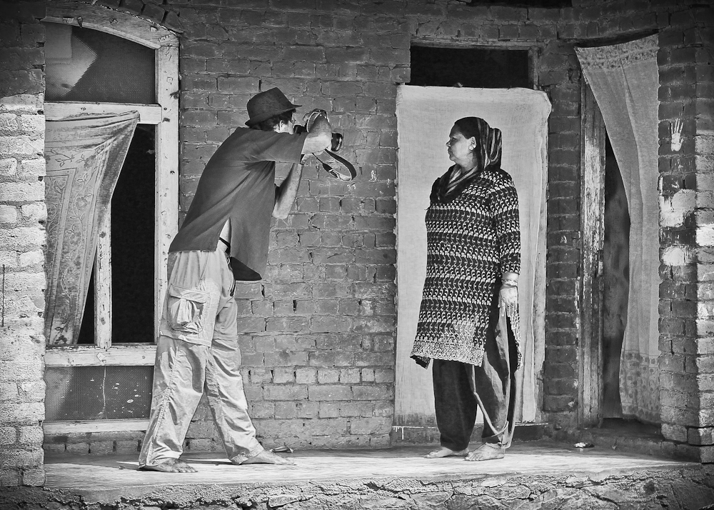 Nelson Guda photographing a widowed Mother in Kashmir